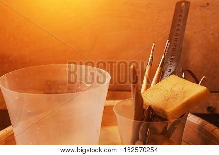 Tools and equipment for working with clay in pottery workshop, free copy space for text