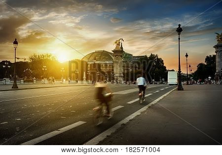 View on Grand Palais in Paris from Pont Alexandre III at sunset, France