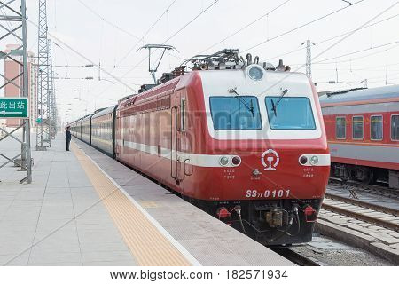 Gansu, China - Apr 09 2015: China Railways Ss7E Electric Locomotive In Wuwei Railway Station, Gansu,