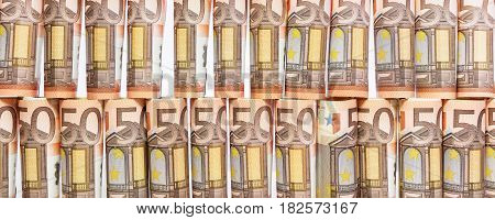 banner with 50 euro notes rolls in front of white background