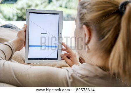 Wroclaw, Poland- April 10Th, 2017:  Woman Launches Instagram Application On Lenovo Tablet. Instagram