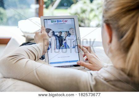 Wroclaw, Poland- April 10Th, 2017:  Woman Launches Bla Bla Car Application On Lenovo Tablet. Blablac