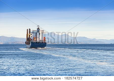 Container Ship Goes On Norwegian Sea, Rear View