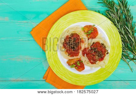 Pasta nest tagliatelle with bolognese sauce on a plate. The top view.