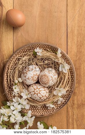 Easter eggs on wooden background. Easter background.