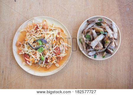 Grill neck pork and papaya salad or som-tam Thai local food