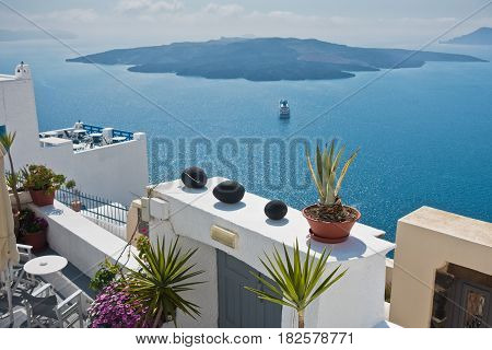 View from Caldera cliff at cruisers and volcanic island, Santorini, Greece