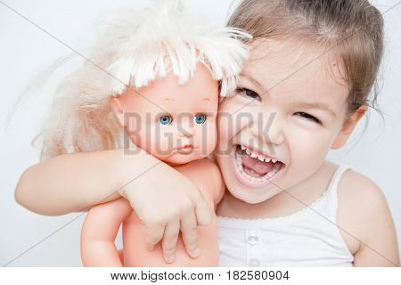 Little girl with a doll, mix race