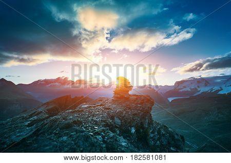 beautifull cloudy sunrise in the mountains with snow ridge. Alps. Switzerland, Trek near Matterhorn mount.