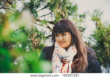Happy Smiling Beautiful Overweight Young Woman In Dark Blue Jacket And Scarf With Anchor Outdoors. C