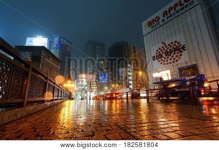 TOKYO, JAPAN - APRIL 8, 2017 - Traffic crosses the bridge to Tokyo's Akihabara district on a rainy night