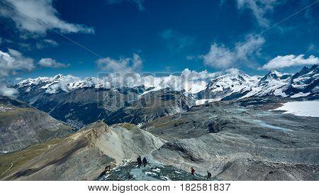 Snow capped mountains. Trek near Matterhorn mount in Swiss Alps