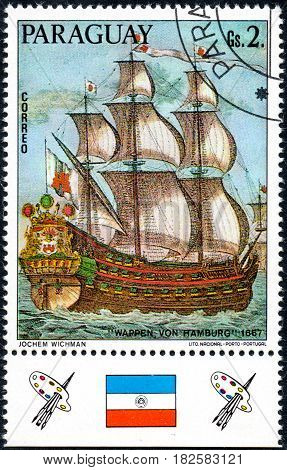 UKRAINE - CIRCA 2017: A postage stamp printed in Paraguay shows sailing ship Wappen von Hamburg 1667 from the series German sailing ships circa 1976