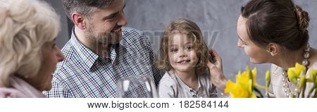 Affectionate picture of young parents with their son the mother stroking his hair during a family dinner