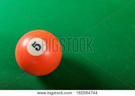 Billiard cue ball on green table. Pool game
