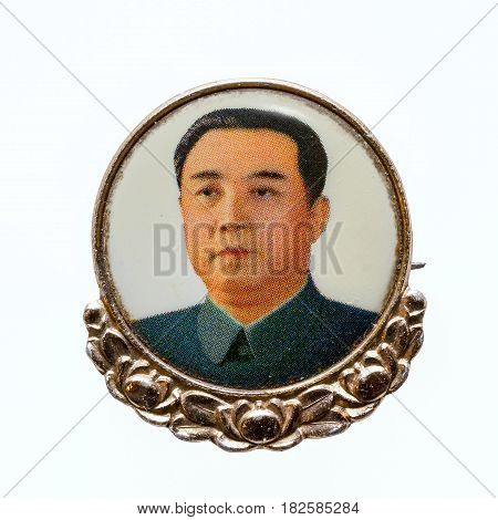 North Korea April 20 2017: Vintage North Korean badge with a portrait of the President of the Democratic People's Republic of Korea DPRK Kim Il-sung (1912 - 1994) isolated on white background