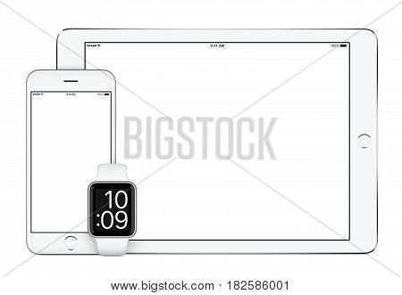 Responsive mockup consisting of white tablet pc, mobile smartphone and smart watch. All gadgets in focus. Isolated on white background. Technology set for responsive design presentation.