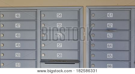 Many Numbered Mailboxes with Outgoing Mail Slot