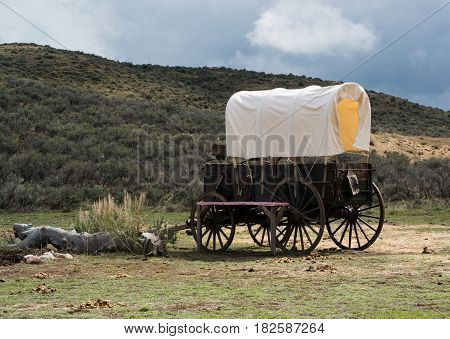 Historic covered wagon chuckwagon in Rocky Mountains
