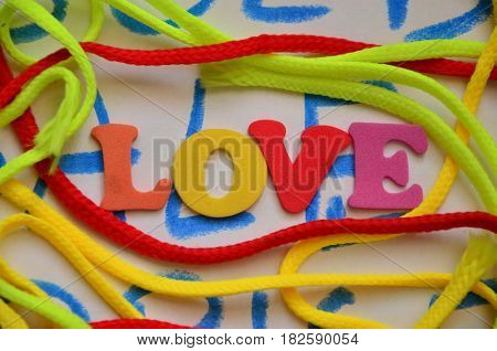 WORD LOVE ON A  ABSTRACT COLORFFUL BACKGROUND