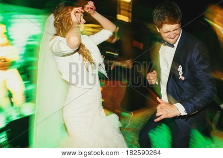 Cool Newlyweds Dance In Green Disco Lights