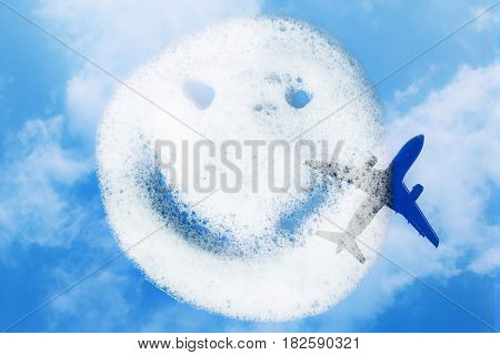Smiley of soap suds on blue background with plane and sky. Double exposure