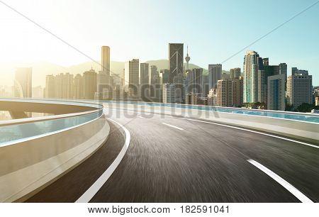 Highway overpass modern city skyline background . Sunrise scene .