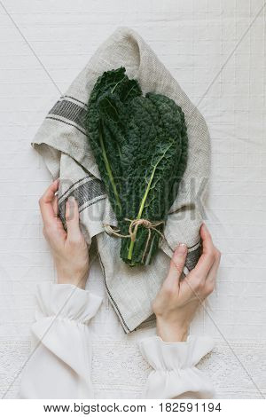 Bundle of Cavolo Nero on White Table Cloth