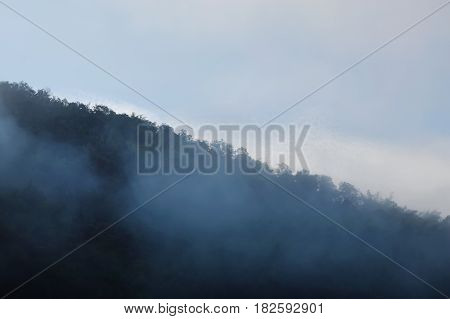 mist floating and cover mountain slope in the morning