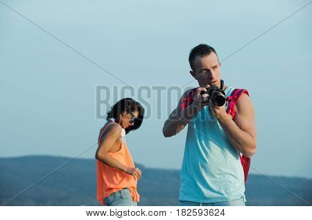 Handsome Man With Camera And Pretty Girl