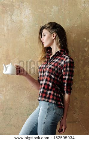 Pretty Girl Holding White Ceramic Tea Pot