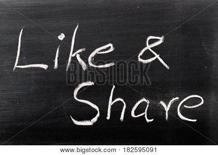 Like & Share wording hand writing by chalk on black board background