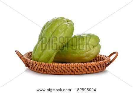 Chayote chokos in basket on white background