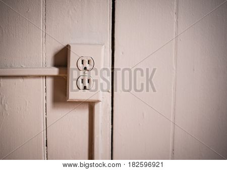 electrical outlet plug in wall of old building