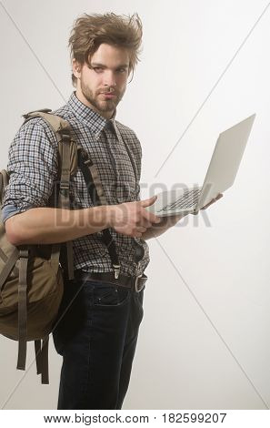 Handsome Man Or Traveler With Backpack And Laptop