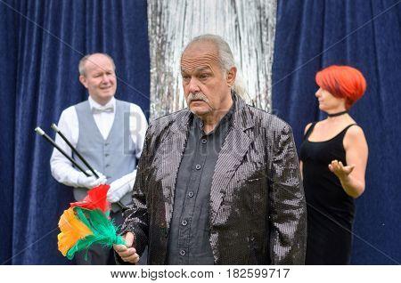 Man Looking At Bright Flowers In Perplexed Disgust