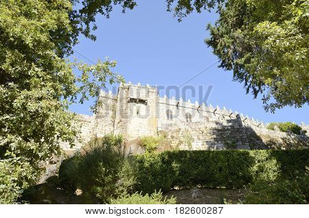SOUTOMAIOR, SPAIN - AUGUST 9, 2016: Medieval Castle of Soutomaior behind a background of trees in the province of Pontevedra Galicia Spain.