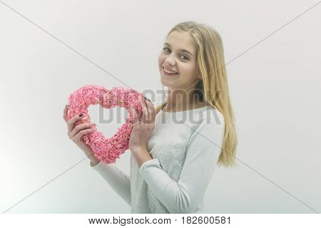Pretty Happy Girl With Pink Wicker Heart For Valentines Day