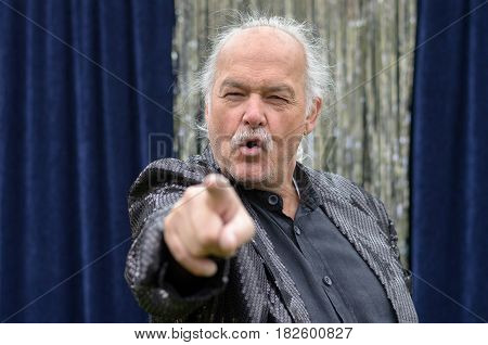Senior Balding Man Pointing At The Camera