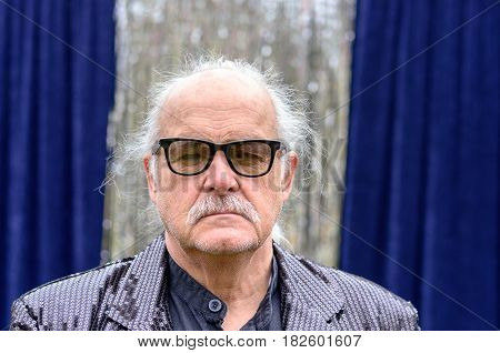 Serious Senior Man Wearing Glasses