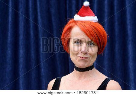 Fun Redhead Woman Wearing A Santa Hat