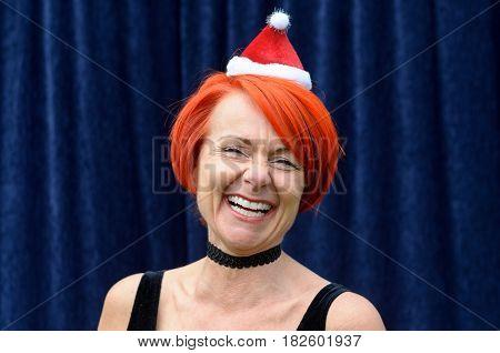 Laughing Vivacious Redhead In A Santa Hat