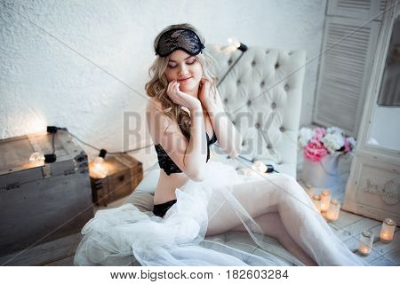 tender blonde in mask on white background