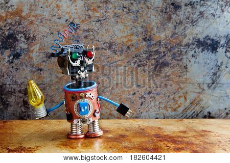 Robotic toy character with yellow lamp in hand, standing rusty iron surface. Vintage textured wall backdrop. Shallow depth field.