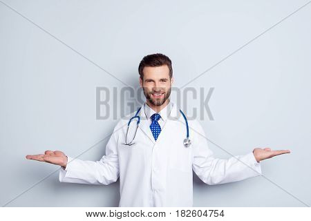 Smiling Specialist In Medical Sphere Standing Against White Background And Asking To Make A Choice B