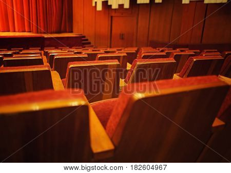 Rows of chairs in conference hall