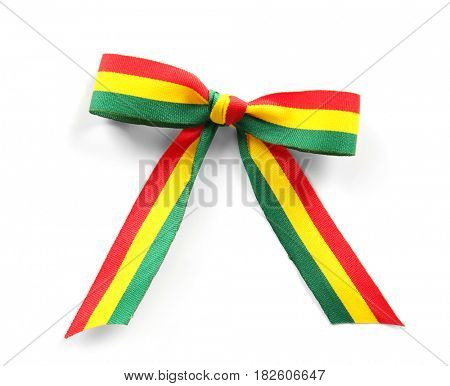 Ribbon bow in colors of Bolivian flag isolated on white