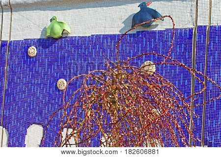 KYIV, UKRAINE - MARCH 18, 2012: Sculptured panel of colorful crows by the sculptor Constantin Skretutsky at Pejzazhna alley the famous children's park in Kyiv, Ukraine