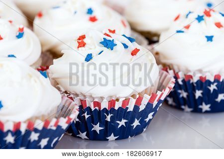 Patriotic 4th of July cupcakes. Red white and blue theme. Closeup with shallow depth of field.