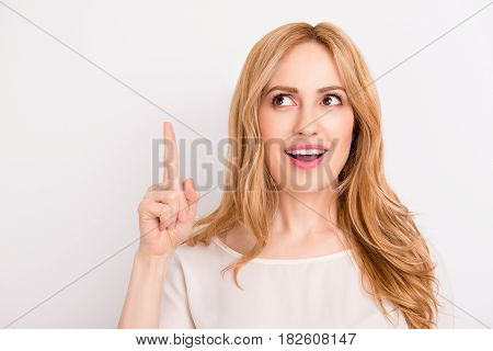 Close Up Portrait Of Pretty Young Smiling  Lady Pointing Up Isolated On White Background